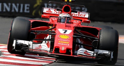 pKimi Raikkonen took pole position on Saturday for the Monaco Formula One Grand Prix, edging out Ferrari team-mate Sebastian Vettel./p