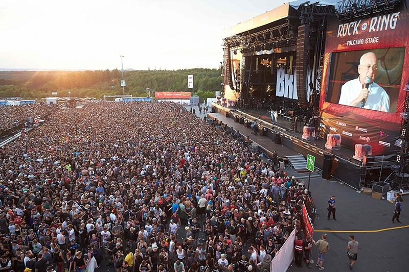 Festival organiser Marek Lieberberg announce the suspension of the program and ask revellers to leave the venue of the Rock am Ring music festival in Nuerburg, western Germany following an evacuation alert amid security concerns. (AFP Photo)