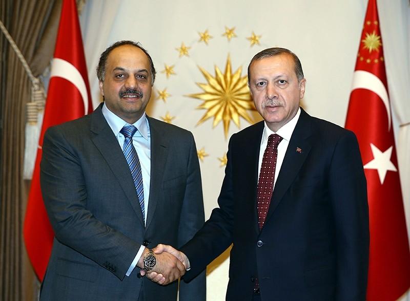 Qatari Defense Minister Khalid bin Mohammed al-Attiyah (L) shakes hands with President Recep Tayyip Erdou011fan at presidential complex in Ankara, Turkey. (IHA Photo)