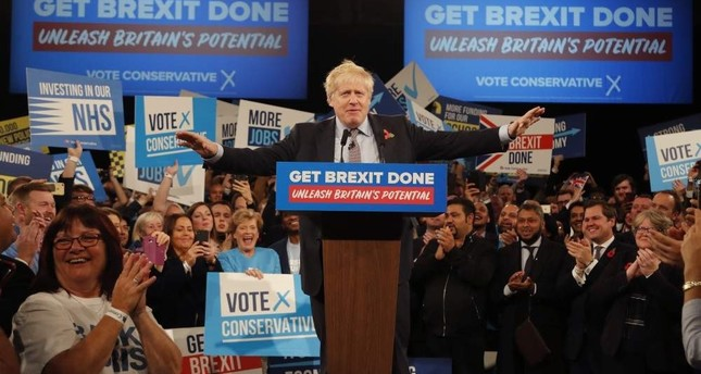 Britain's Prime Minister Boris Johnson speaks during an election campaign event for his ruling Conservative Party at the National Exhibition Center, Birmingham, Nov. 6, 2019. AP Photo
