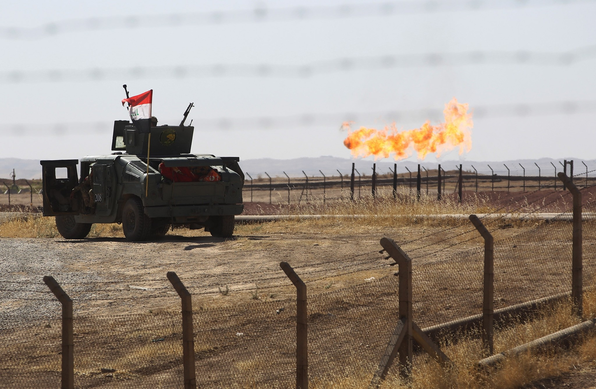 A picture shows an Iraqi army vehicle at the country's Bai Hassan oil field west of Kirkuk on October 17, 2017.  (AFP Photo)