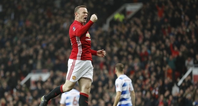 Manchester United's Wayne Rooney celebrates scoring their first goal.