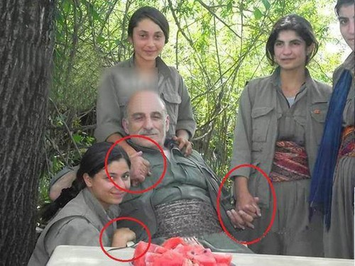 PKK leader Duran Kalkan with young girls.