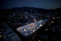 Attendees at this year's Winter Olympics will get a chance to step into space—almost.