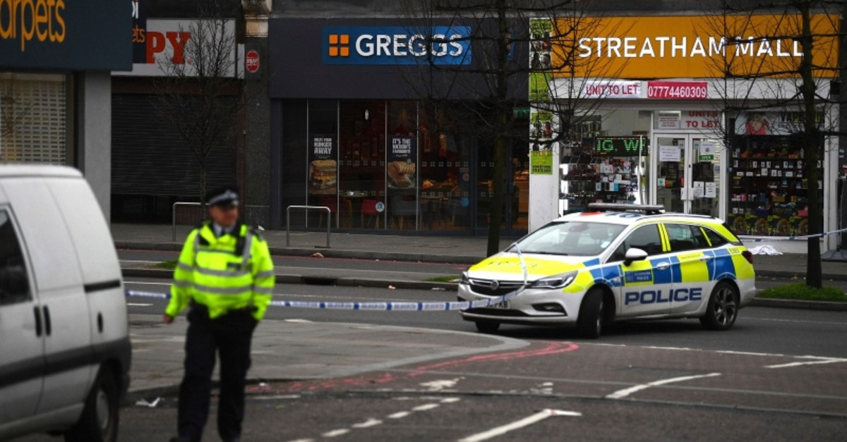 Police attend the scene after an incident in Streatham, London, Sunday Feb. 2, 2020. London police say officers shot a man during a u201cterrorism-related incidentu201d that involved the stabbings of u201ca number of people.u201d (Victoria Jones/PA via AP)