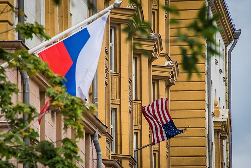 This file photo taken on July 31, 2017 shows a Russian flag flying next to the U.S. embassy building in Moscow. (AFP Photo)