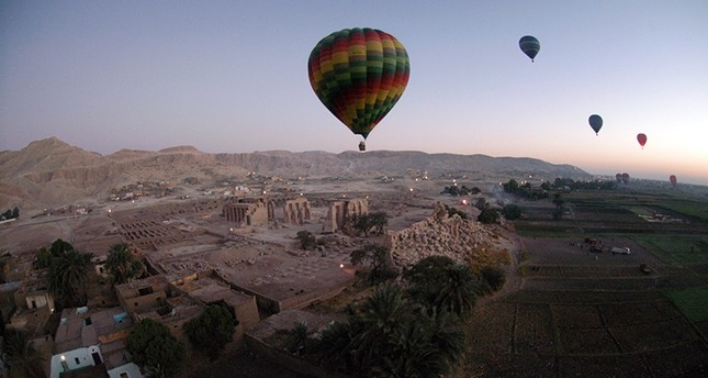 This file photo taken on November 15, 2007 shows tourist hot air balloons floating during dawn across Egypt's Valley of the Kings, near Luxor. (AFP Photo)