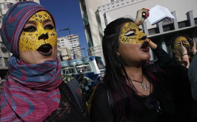Activists with their faces painted like jaguars protest the reelection of President Evo Morales, in La Paz, Bolivia, Wednesday, Oct. 30, 2019. (AP Photo)