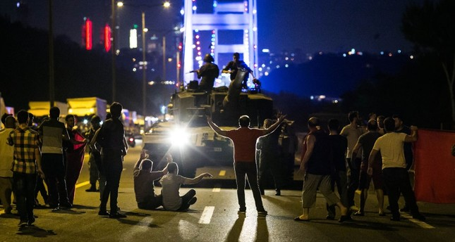 People take over a tank near the Fatih Sultan Mehmet Bridge during resistance against the deadly FETÖ-led coup attempt on the night of July 15, Istanbul.