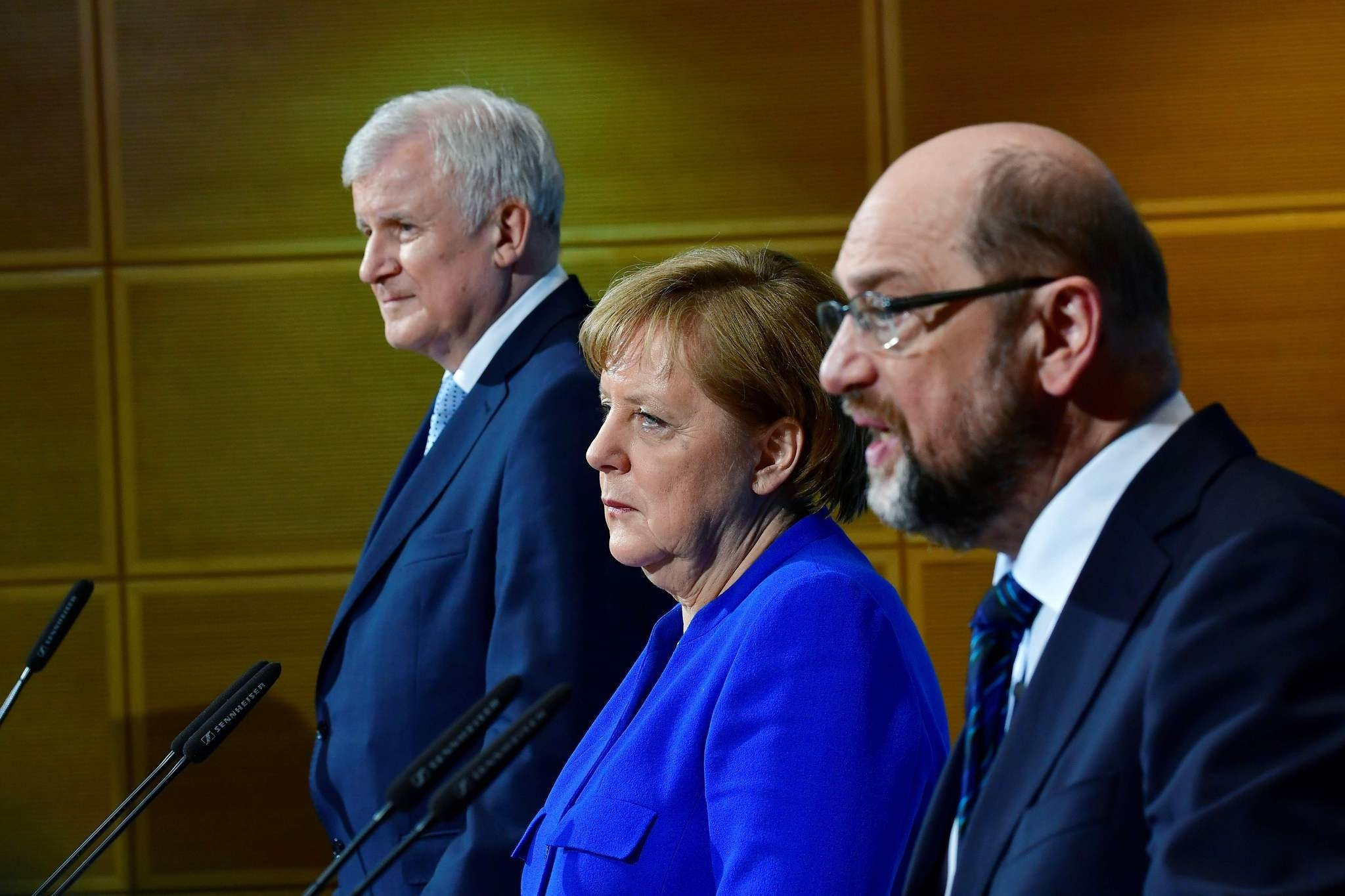 German Chancellor Angela Merkel's conservatives reached a ,breakthrough, deal with the country's second biggest party, the Social Democrats, toward building a new coalition government, sources close to the negotiations said. (AFP Photo)