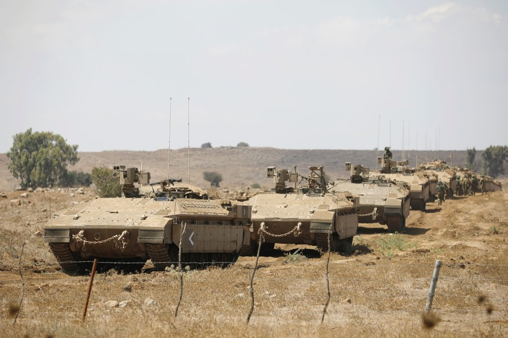 Israeli armored vehicles take part in a military drill in the Israeli-occupied Golan Heights, Aug. 7.