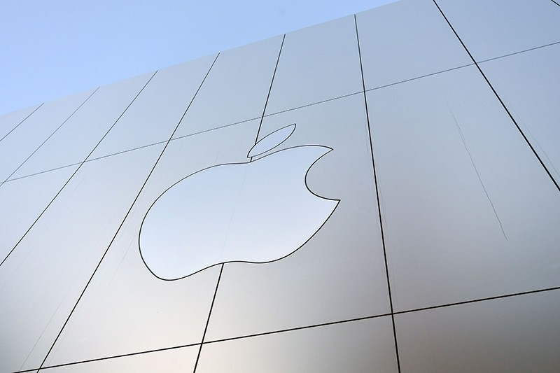 This file photo taken on September 22, 2017 shows an Apple logo on the outside of an Apple store as new iPhones are released for sale in San Francisco, California. (AFP Photo)