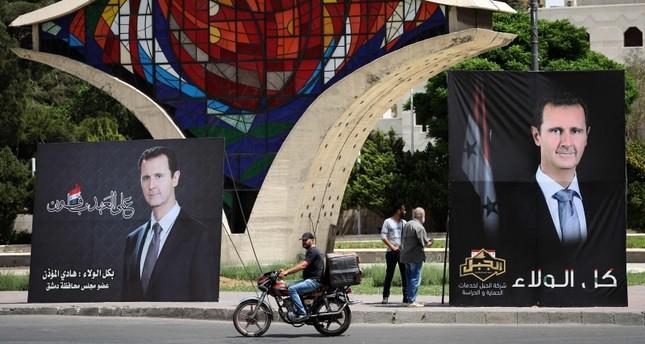 ملصقات دعائية لرئيس النظام السوري لأجل الانتخابات الرئاسية في دمشق الفرنسية