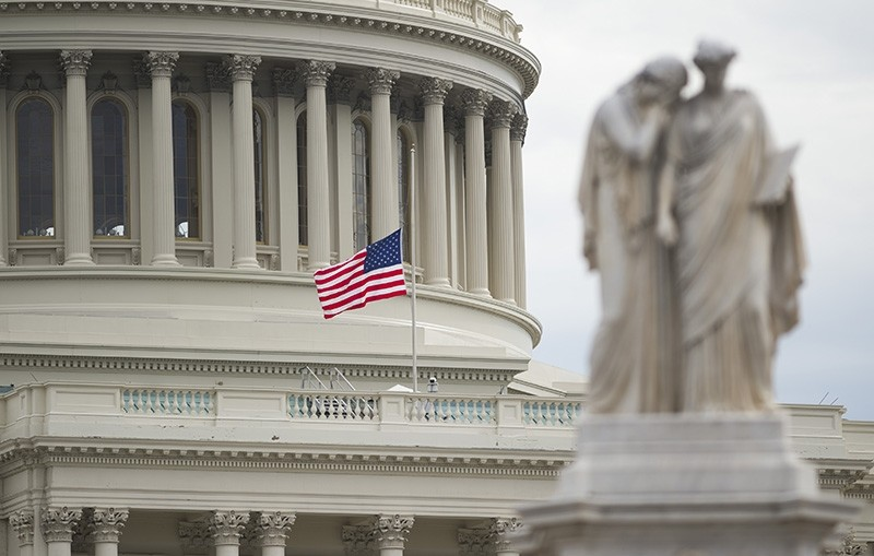 An American flag flies at half staff over the U.S. Capitol in Washington, DC, Feb. 15, 2018, following a school shooting in Florida yesterday. (AFP Photo)