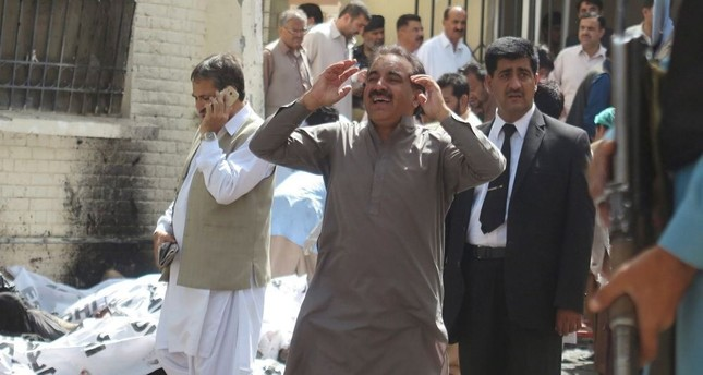 A man reacts after a bomb blast in restive Quetta, Pakistan.