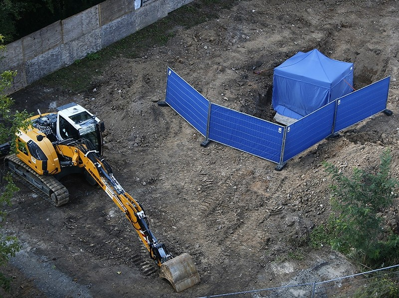 A blue tent covers an unexploded 1.8 tons WW II bomb in Frankfurt, Germany, Friday, Sept. 1, 2017. (AP Photo)