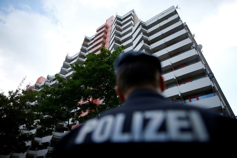 German police secures the area around the apartment of 29-year-old Sief Allah H., in Cologne, Germany, June 15, 2018. (Reuters Photo)