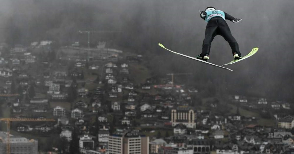 Japan's Keiichi Sato competes during the men's FIS Ski Jumping World Cup competition, Engelberg, Dec. 22, 2019. (AFP Photo)