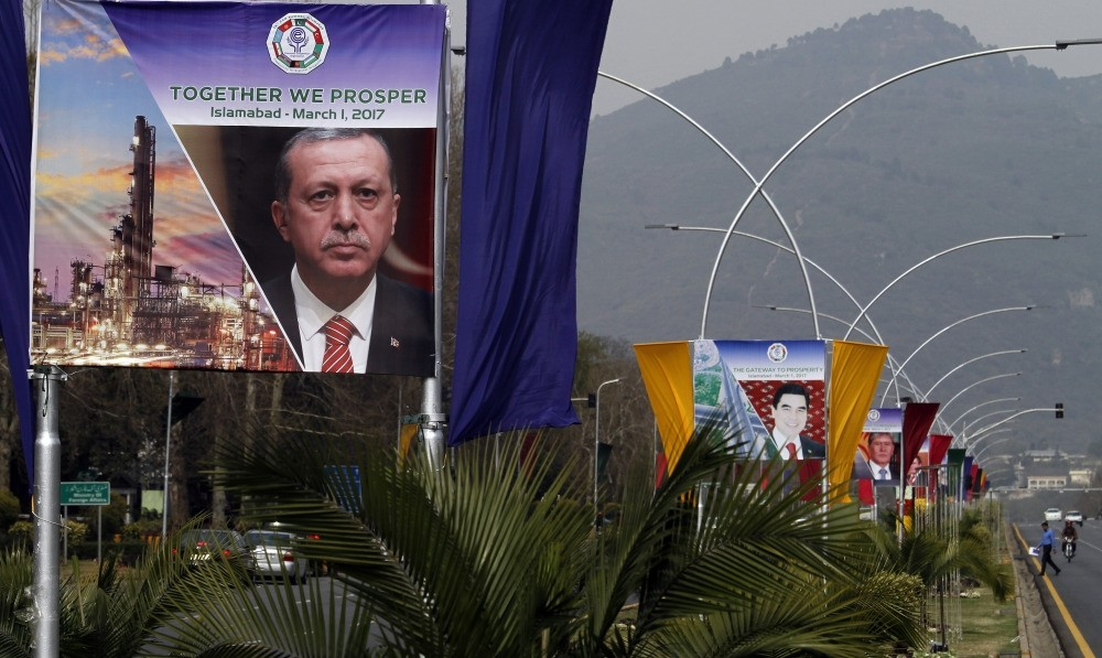 Billboards splashed with images of the presidents of Turkey, Turkmenistan and Kyrgyzstan on display at a main highway to welcome the leaders in Islamabad, Pakistan Tuesday.