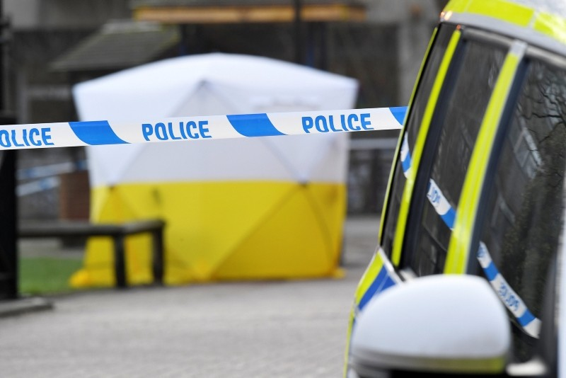 A police car is parked next to crime scene tape, as a tent covers a park bench on which former Russian inteligence officer Sergei Skripal was found unconscious in Salisbury, Britain, March 6, 2018 (Reuters Photo)