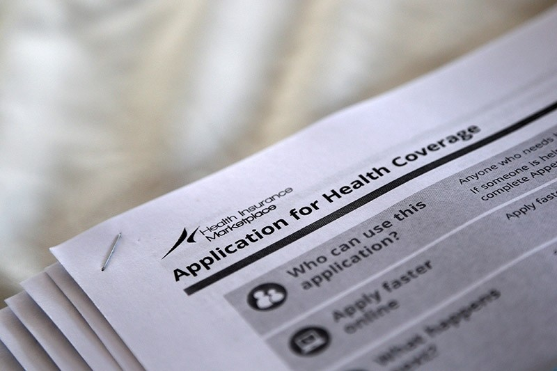 The federal government forms for applying for health coverage are seen at a rally held by supporters of the Affordable Care Act, widely referred to as ,Obamacare, in Jackson, Mississippi. (Reuters File Photo)