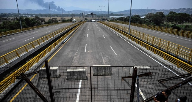 Containers block the Tienditas bridge, with a stage in the background -where a concert will take place on Saturday 23- in Urena, Venezuela, on the border with Colombia, on February 20, 2019. (Reuters Photo)