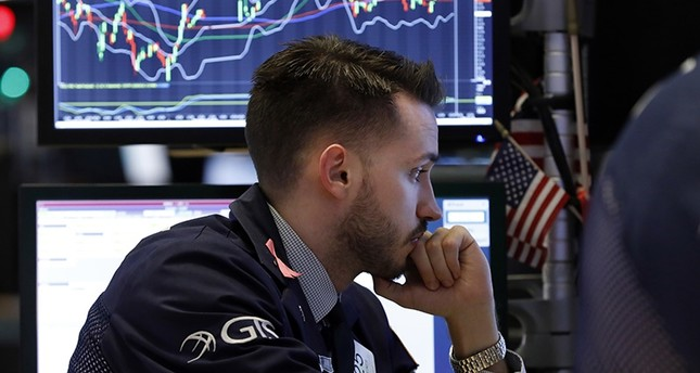 Specialist Matthew Greiner works at his post on the floor of the New York Stock Exchange, Friday, Dec. 28, 2018. (AP Photo)