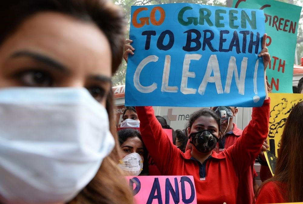 Protesters wearing protective masks in a rally urging  action to curb air pollution in New Delhi.