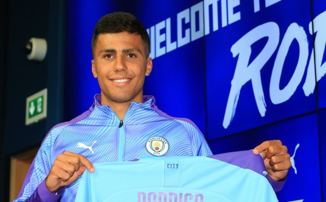 Manchester City's new signing Rodri displays his shirt during a press conference at the Etihad stadium in Manchester, northwest England on July 4, 2019.