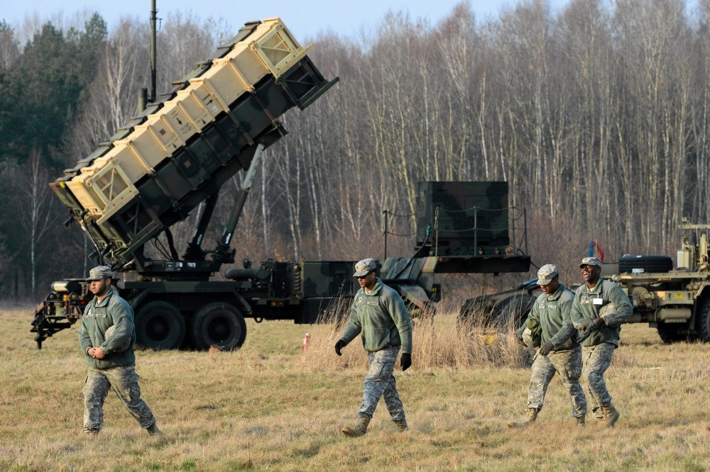 U.S. soldiers walk next to a Patriot missile defense battery during an exercise in Warsaw, Poland, 2015.
