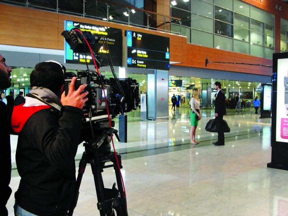 Camera crew films at Sabiha Gu00f6ku00e7en Airport in Istanbul, Turkey.