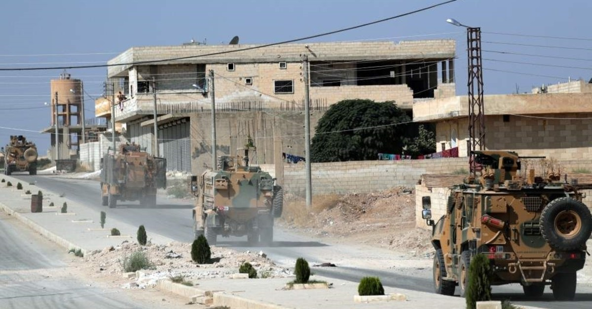 Turkish military vehicles in the town of Tal Abyad, Syria, Oct. 23, 2019. (REUTERS)