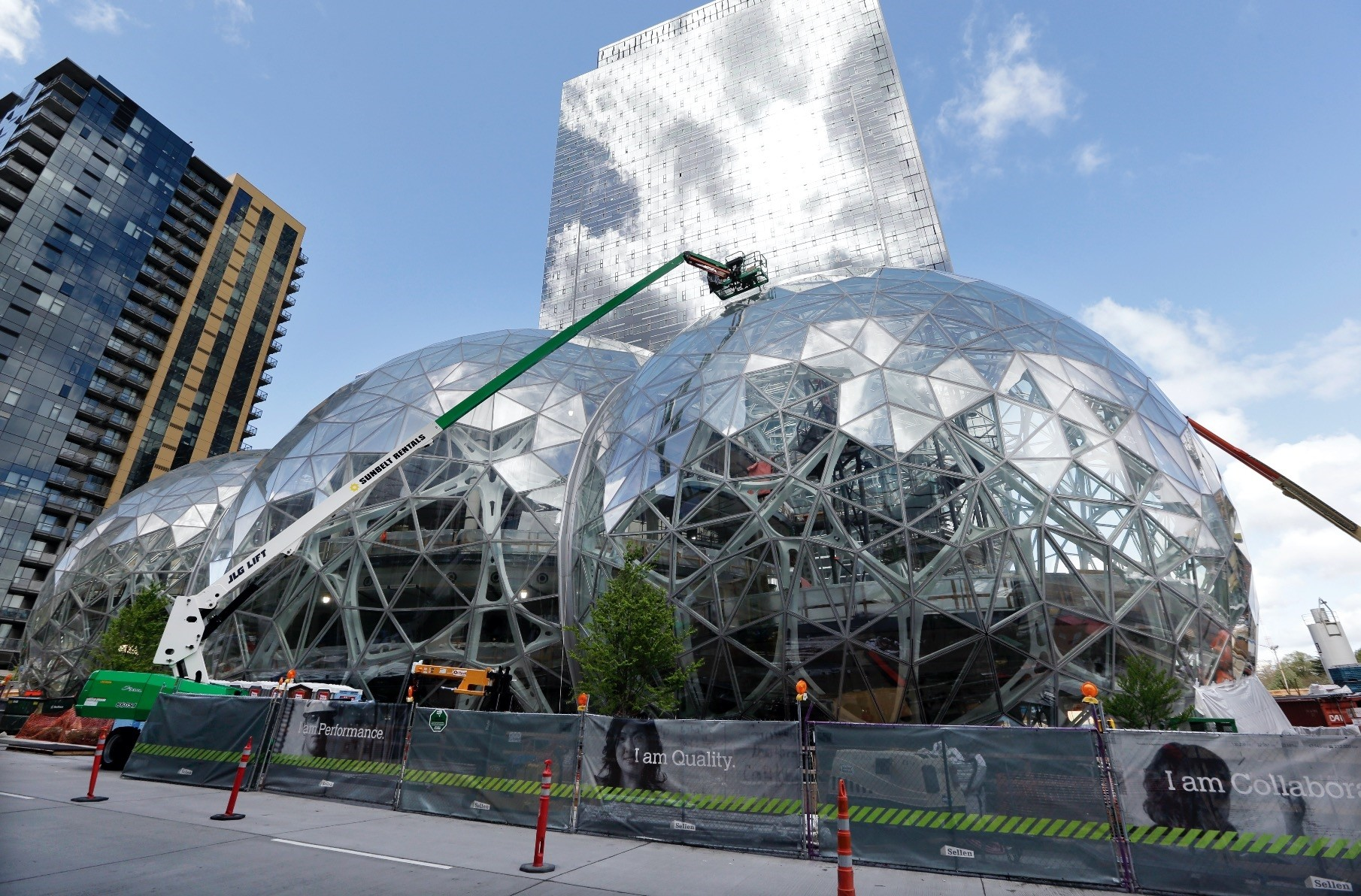 Construction continues on three large, glass-covered domes as part of an expansion of the Amazon.com campus in downtown Seattle. The structures are expected to begin being used by employees in early 2018.