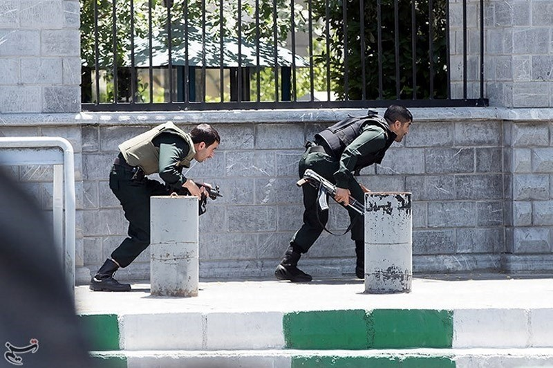 Members of Iranian forces take cover during an attack on the Iranian parliament in central Tehran, Iran, June 7, 2017. (Reuters Photo)