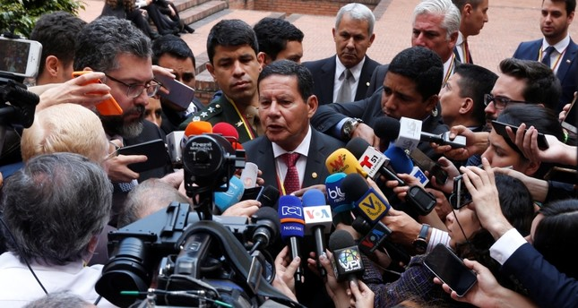 Brazil's Vice President Hamilton Mourao speaks to the media after a meeting of the Lima Group in Bogota, Colombia, February 25, 2019. (Reuters Photo)