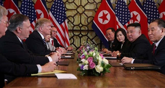 NKorea's leader Kim Jong Un and U.S. President Donald Trump attend bilateral meeting with U.S. Secretary of State Mike Pompeo, NKorean Foreign Minister Ri Yong Ho and other officials at summit in Hanoi, Vietnam, Feb. 28, 2019. (Reuters Photo)