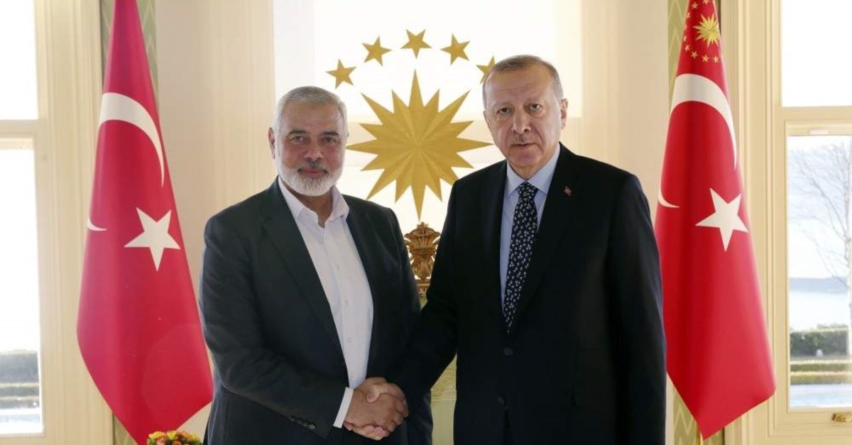 President Recep Tayyip Erdo?an, (R), shakes hands with Hamas movement chief Ismail Haniyeh, prior to their meeting in Istanbul, Feb. 1, 2020. (AP PHOTO)