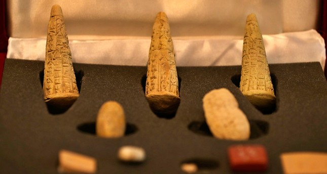 Recently recovered antiquities are displayed at the foreign ministry, in Baghdad, Iraq, Monday, July 29, 2019 (AP Photo)