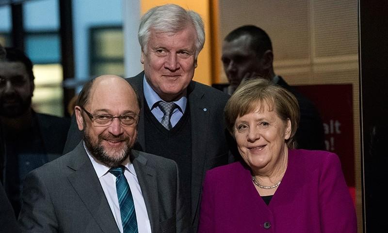 SDP leader Martin Schulz, front left, German Chancellor and CDU chairwomen Angela Merkel, front right, and CSU head Horst Seehofer, rear center, arrive for coalition talks in Berlin, Germany, Feb. 2, 2018. (Bernd von Jutrczenka/dpa via AP)