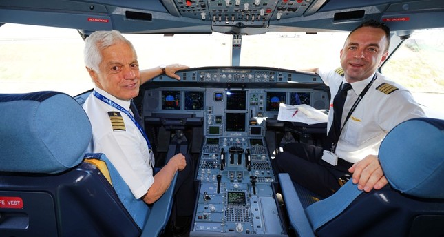 Turkish Airlines (THY) Captain Kemal İnce (L) was accompanied by his son İnanç İnce (R), also a THY pilot, during the final flight of his 45-year career.