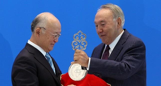 International Atomic Energy Agency (IAEA) Director General Yukiya Amano (L) and Kazakh President Nursultan Nazarbayev take part in a video link, dedicated to the opening of the Low Enriched Uranium (LEU) Bank in Kazakh city of Oskemen (Reuters Photo)