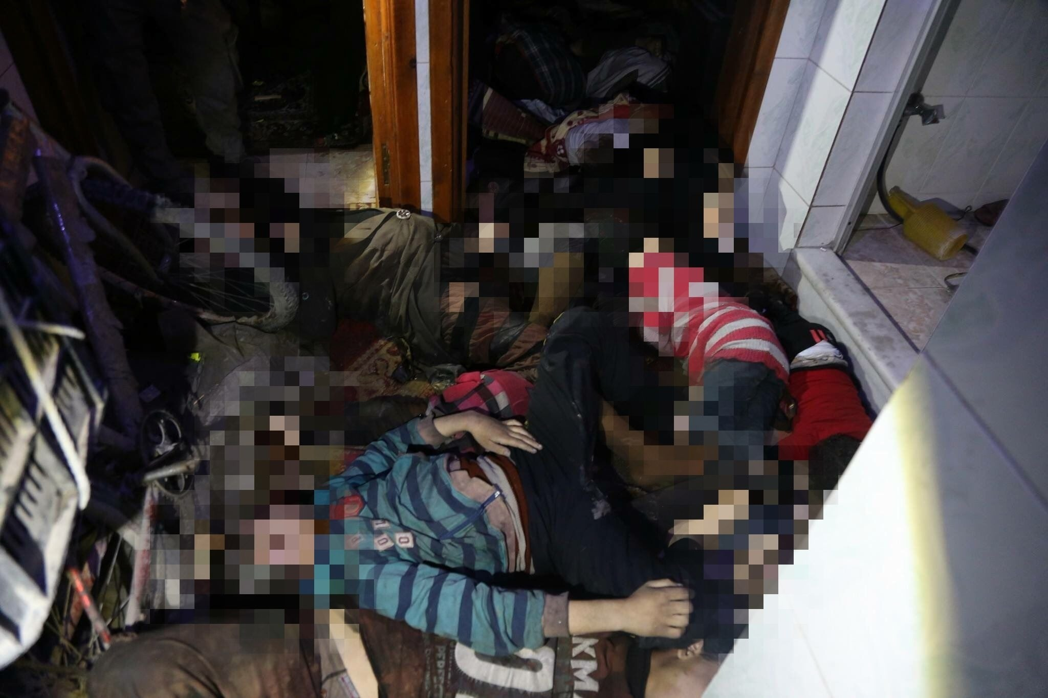 A handout image released by the Syrian Civil Defence on their Social Media pages on April 8, 2018, shows bodies inside a room following an alleged chemical attack on the rebel-held town of Douma. (AFP Photo)