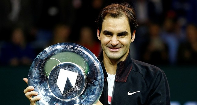 Roger Federer of Switzerland holds the trophy after winning against Grigor Dimitrov of Bulgaria. (Reuters Photo)