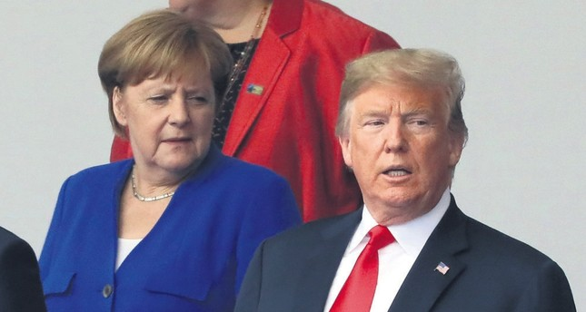 German Chancellor Angela Merkel and U.S. President Donald Trump exchanged barbs while getting off to a prickly start at the NATO summit, Brussels, July 11.