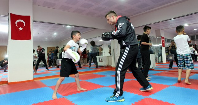 Ünal Aşık teaches a student Muay Thai. He is one of four officers devoting their days off to children in the city of Hakkari.