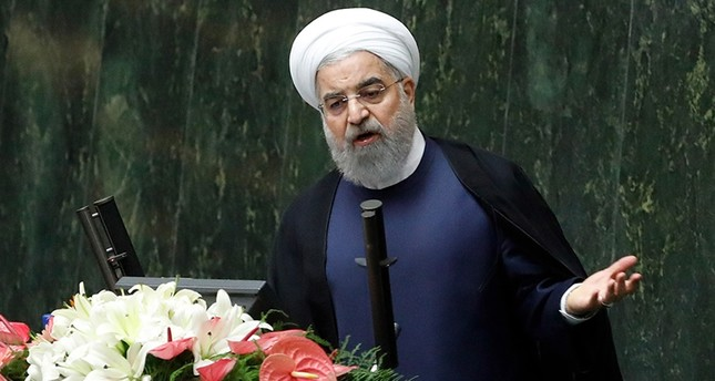 Iranian President Hassan Rouhani (C) delivers a speech to the parliament in Tehran on Aug. 20, 2017, as Iran's parliament prepares to vote on the President's cabinet. (AFP Photo)
