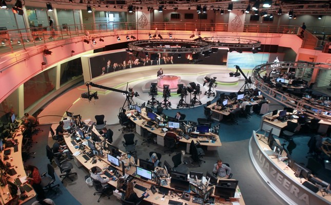 Staff work at the headquarters of the Al-Jazeera network in Doha, Qatar, June 8.