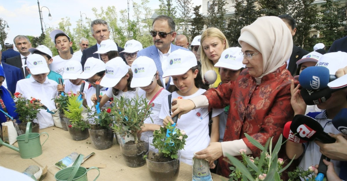 First lady Emine Erdou011fan plants flowers using compost made of recycled waste at an event at the Presidential Complex, June 2018.