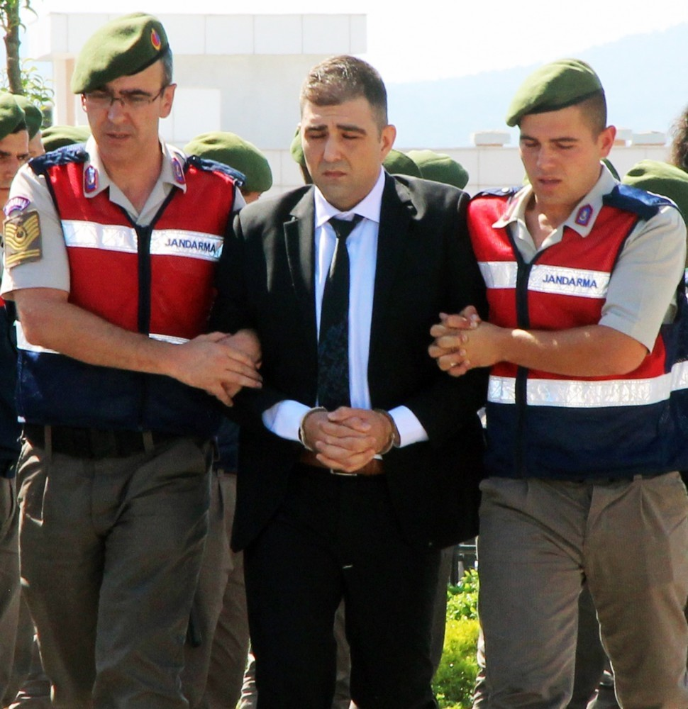 Gendarmerie officers escort Haydar Murat u00d6zden to court. u00d6zden transported would-be assassins of President Erdou011fan to the hotel where he had been staying during the coup attempt.
