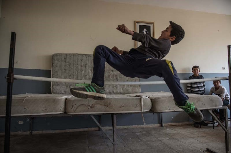 Student practices the long jump using makeshift equipment after school in Gaziantep Province. (Anadolu Agency Photo)